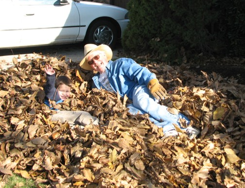 If you're four, you can jump into a HUGE pile of leaves, walnuts and all.